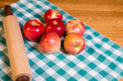 Red apples and rolling pin Stock Photography