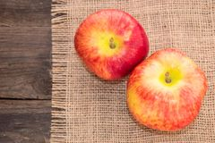 Red apples on a rustic background. Tasty, juicy, ripe, red apples on a rustic background on a wooden table Royalty Free Stock Photos