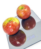 Red Apples on a Scale Stock Images
