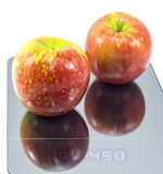 Red Apples on a Scale Stock Photo