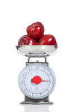 Red apples on a scale on white Stock Photography