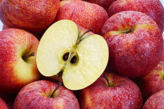 Red Apples. Several Red Apples with cut apple in the foreground Stock Photos