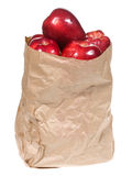 Red apples in shopping paper bag Stock Photos