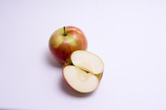 Red apples with slice isolated on the white background.  Royalty Free Stock Images