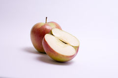 Red apples with slice isolated on the white background.  Stock Photography