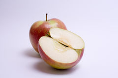 Red apples with slice isolated on the white background.  Royalty Free Stock Image