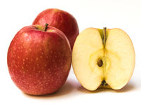 Red apples and slice on a white background. Royalty Free Stock Photography