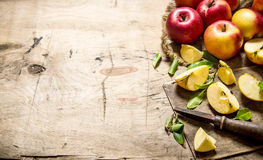Red apples sliced with a knife. Free space for text . Royalty Free Stock Images