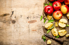 Red apples sliced with a knife. Free space for text . Royalty Free Stock Photo