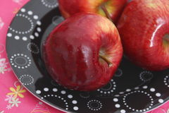 Red apples. Some red apples on a black plate royalty free stock images