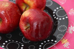 Red Apples. Some red apples on a plate stock images