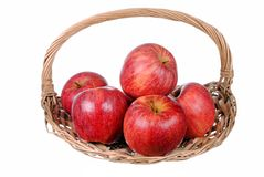 Red apples in a straw basket Royalty Free Stock Photos