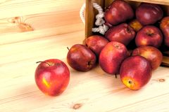 Red apples on table in wooden crate, pile of fresh apple . Red apples on table in wooden crate, pile of fresh apple Stock Images