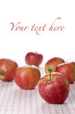 Red apples on tablecloth Royalty Free Stock Photos