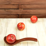 Red apples and tea cup with tea bags Stock Images