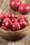 Red apples in a timber bowl Stock Photos