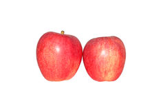 Red apples. Two red apples on a white background Royalty Free Stock Images