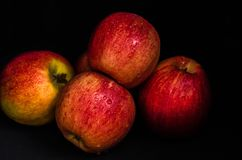 Red apples. With water drops on a black background stock photo
