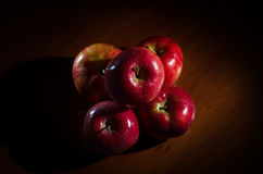 Red apples with water drops on a wooden table. Royalty Free Stock Photo