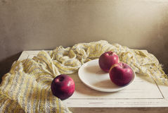 Red apples on white plate royalty free stock photography