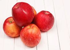 Red apples on a white table. Red apples on a white wooden table Stock Photography