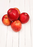 Red apples on a white table. Red apples on a white wooden table Royalty Free Stock Photo