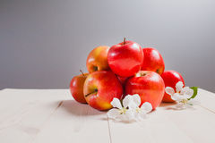 Red apples on a white wood table Royalty Free Stock Images