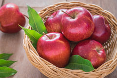 Red apples in wicker basket Royalty Free Stock Image