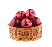 Red apples in a wicker basket. Fruit. Royalty Free Stock Images