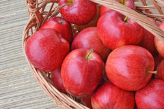 Red apples in a wicker basket Royalty Free Stock Photography
