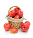 Red apples in a basket on a white background Stock Photo