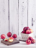 Red apples on a wite rustic wood table Stock Photography