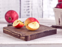 Red apples on a wite rustic wood table Royalty Free Stock Photography