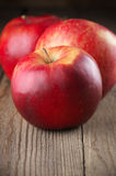 Red apples on wood Royalty Free Stock Photography