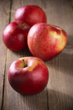 Red apples on wood Royalty Free Stock Photos