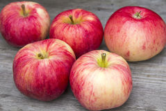 Red apples. On a wooden Royalty Free Stock Image