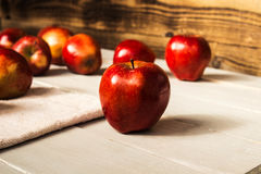 Red apples on wooden background royalty free stock images