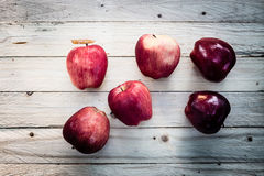 Red apples on wooden background Royalty Free Stock Photography
