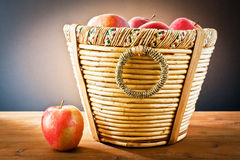 Red apples on wooden basket Royalty Free Stock Images