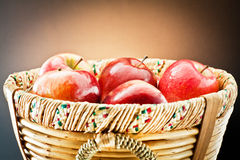 Red apples on wooden basket Royalty Free Stock Image
