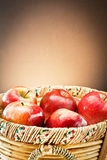 Red apples on wooden basket Royalty Free Stock Photography