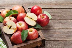 Red apples in wooden box Stock Image