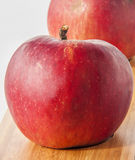 Red apples on wooden table Royalty Free Stock Images