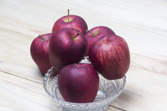 Red apples on a wooden table. Closeup shot of fresh red apples royalty free stock photo