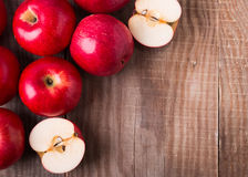 Red apples on the wooden table Stock Photography