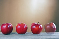 Red apples on a wooden table Stock Photography