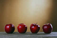 Red apples on a wooden table Royalty Free Stock Photos