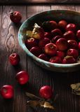Red apples on a wooden table. Red apples on a dark wooden table stock image