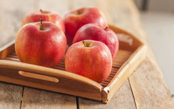 Red apples on wooden table, selective focus Stock Photos