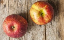Red apples on wooden table, selective focus Royalty Free Stock Photo